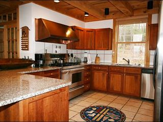 Stowe house photo - Granite Counters and Stainless Steel Appliances in the Kitchen