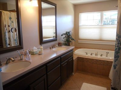 master bathroom, tub for 2 & shower for 2 - save water!