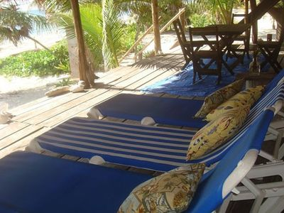 4 beach chairs and dining on the palapa