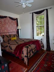 Healdsburg cottage photo - Front bedroom features lovely black iron queen bed with vibrant bedding.