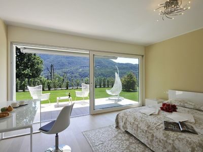 Collina d'Oro apartment rental - Double bedroom suite with access to garden