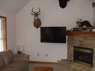 Living Room w/ 55  wide screen (HBO & Starz). Home is equipped with WIFI.