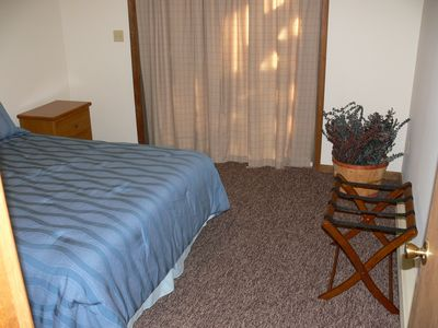 Lake Wallenpaupack house rental - Queen Bedroom on 1st Floor with sliding glass door. Dresser and night stand.