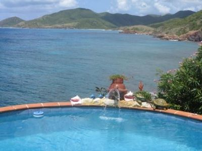 Stunning views up the Antiguan coastline from the pool and lounging deck