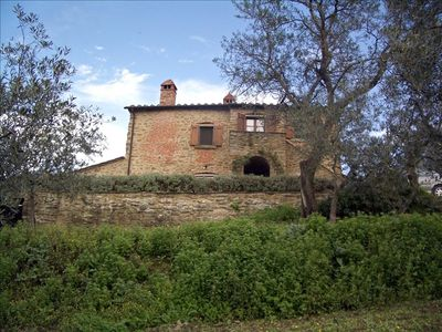 Front of house from below in the olive tree grove