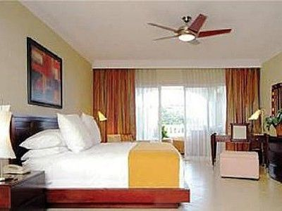 Puerto Plata condo rental - The king-size bed then sliding doors to the furnished lanai.
