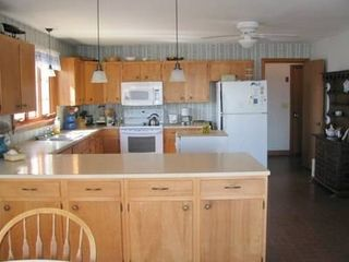 Pocasset house photo - Kitchen with eat-in bar; new stove, overhead microwave, dishwasher.
