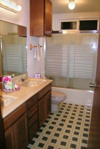 Full size bathroom with double vanity view 2