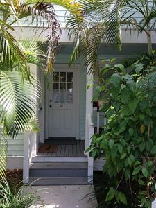 Our townhouse has a mint green gingerbread Key West cottage look outside