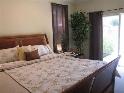 Master bedroom, has a master bathroom, and sliding glass door leading to patio