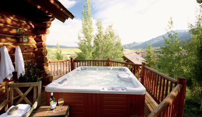 Entry level sun deck overlooks Teton Village Center & resort ski mountain