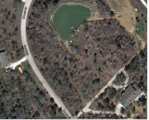 Austin house photo - Aerial view of land. See the house to the right and the pond! Very private!