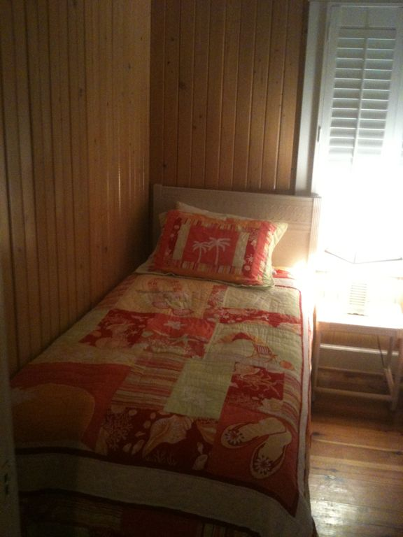 Twin bed in back bedroom