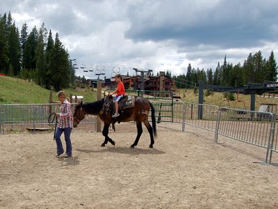 Horseback rides for children. Sierra House in the background