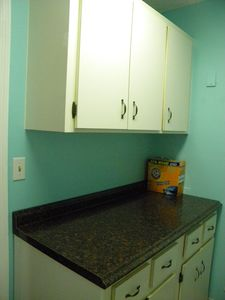 Laundry room with ample storage and counter space.