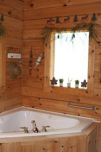 Both bathrooms feature jetted tubs and walk in showers.