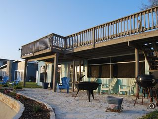 Rockport house photo - Back patio- guaranteed fun with firepit, BBQ pits, Fish Fryer- all with a VIEW!