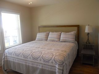 Gulf Shores property rental photo - upstairs bedroom, king bed, with view of ocean