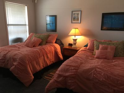 Shows double beds in bedroom updated with new comforters & pillows.
