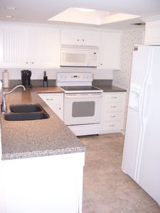 New appliances, cabinets, countertops & flooring