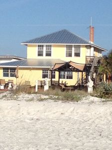 The beach cottage is just steps to the right of our our beach house pictured.