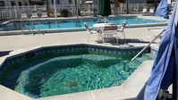 55+ Mobile Home Park w/ heated pool, shuffleboard, pool, library and gym.
