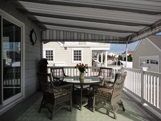 Avalon cottage photo - Covered back deck. dining table with outdoor carpet