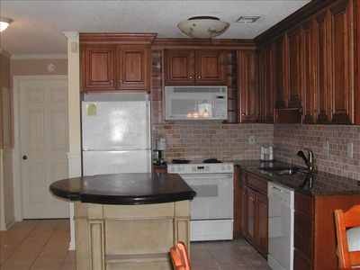 Kitchen with granite countertop and island