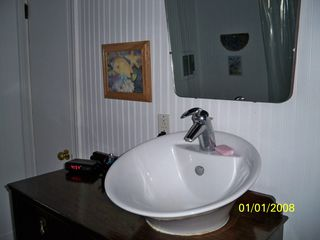 Gloucester house photo - Vessel wash basin on an antique stand
