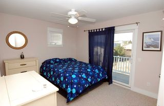 Bethany Beach house photo - Rear Queen Jr. Master BR with access to hot tub and pool via outdoor stairs