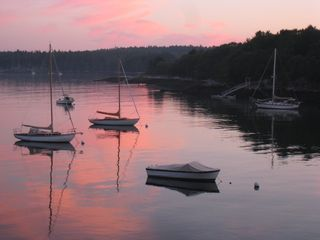 Westport Island cottage photo - Calm cove with boats at sunset