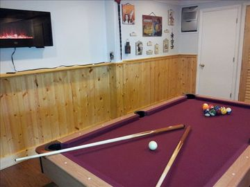 Downstairs Game Room with Wall Mounted Fireplace & Pool Table