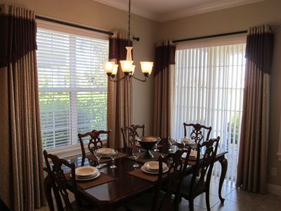 Dining conveniently next to kitchen and living room with door to patio and golf