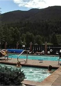 Pool and hot-tub for summer or winter use with mountain view