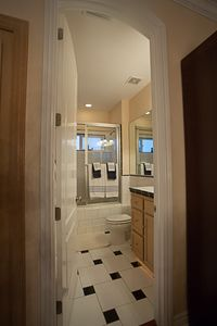 Upstairs Hall bathroom with jacuzzi bath and tall shower combo.