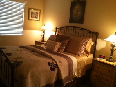 Upstairs bedroom with queen bed, walk-in closet and cable television.