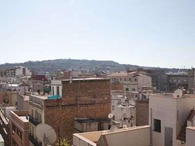 El Raval apartment rental - The view of Mount Montjuic from the apartment terrace