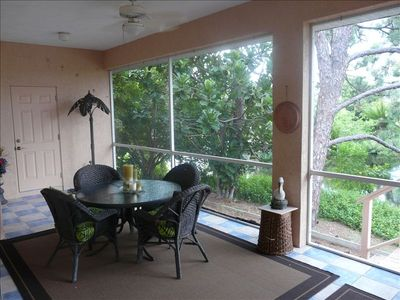 Enjoy the peaceful views of Amberjack Creek from the large lanai .