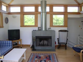 Chilmark house photo - the LR fireplace and TV w/ DVD player, my back is to the railed deck