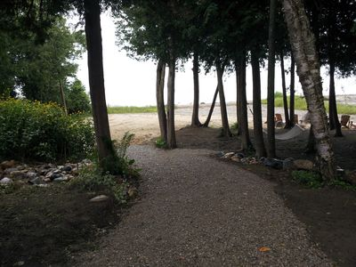 Torch Lake house rental - Path to the beach and firepit, Relax under the trees in the hammock!