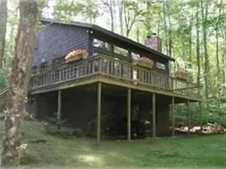 Ludlow chalet photo - 4 season rental with large open wrap around decking and covered patio on 1 acre