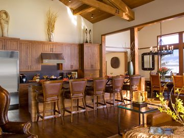 Rustic kitchen with gourmet appliances and plenty of seating