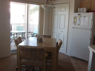Port St. Lucie condo photo - Kitchen table off kitchen with sliders to the balcony. Balcony overlooks pool.