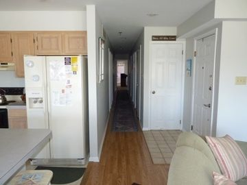 Hallway leading to bedrooms and bathrooms