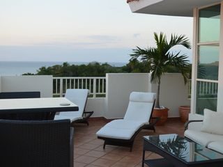 Aguadilla condo photo - Endless ocean views - spacious outdoor living area - comfortable furniture