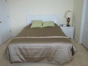Guest Bedroom with Queen Size Bed and view of ocean shoreline