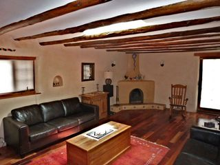Santa Fe house photo - Living room with Kiva fireplace