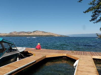 Big Arm cabin rental - Looking at Wild Horse & Mission Mts from dock Sailboat races around Island