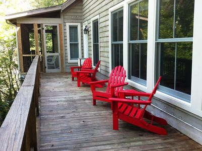 Lounging deck bridges two screened porches, lakeside