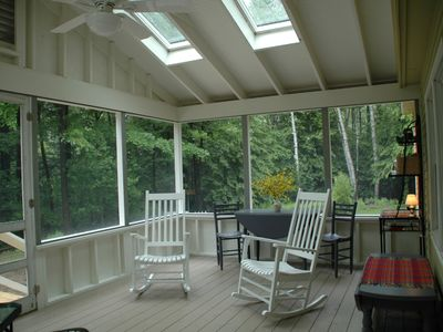 Relax, dine and enjoy the large screened porch